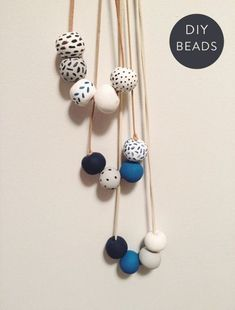 An Indigo DIY Materials colored clay suede cord or hemp a baking sheet a toothpick acrylic paint paintbrushes Directions Roll the clay into. Polymer Clay Necklace, Polymer Clay Beads, Clay Earrings, Fimo Clay, Polymer Clay Projects, Clay Crafts, Ceramic Jewelry, Ceramic Beads, Wooden Beads