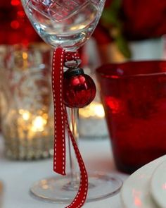 ciao! newport beach: christmas table details. *** love the ornament tied with ribbon to the stemware***
