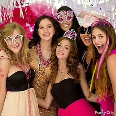 Create an Instagram-worthy photo booth with pretty in pink accessories like hair extensions, tiaras, and glam star glasses!