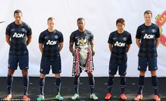 Rio Ferdinand, Tom Cleverley, Patrice Evra, Shinji Kagawa and Jonny Evans show off United's new away kit