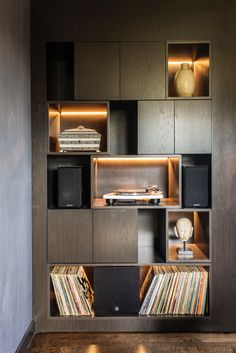 Moedern wall unit in executive office at the San Francisco Decorators Showcase House 2017. Antiques. Dark wood finish. Turntable. Grey Room.