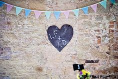 bunting and signage | Ciaran and Louise's perfectly pastel Borris House wedding by Katie Kav | www.onefabday.com