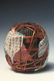 """Nancy Moore Bess, """"Tea Jar,"""" waxed linen thread, African bead, bamboo, old Japanese book pages, handmade paper, waxed cotton ties"""