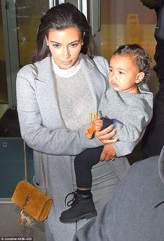 Baby has a toy: North West was seen holding Pokey from the Gumby series when stepping out with mother Kim Kardashian in New York City on Friday