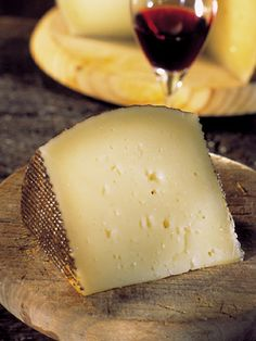 Manchego - Spain, comes from  Machega sheep. Buttery yet zesty w/ sheep's  milk quality. Manchego Curado is smooth easy-eating for , sandwiches or salads. Manchego Viejo, is more intense and best served w/ olives, quinces and tied together w/ bread.