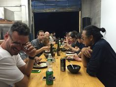 Rikrit Tiravanija and his guests enjoying a Thai dinner. Tiravanija has been incorporating cooking into his conceptual art since the early 1990s.
