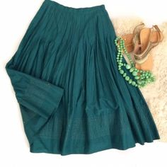 Anthropologie Jade Green Gold Pleated Skirt Stunning skirt from Anthropologie. Size 2. Only worn once. Deep jade green color with gold bottom stitching. Snap side closure. Perfect mid ankle length. Flowing pleats make this so elegant and perfect for so many occasions! Anthropologie Skirts