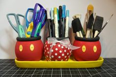 Dollar store find turned into Disney organizer. It's three flower pots and a tray painted Mickey colors. I so need a set! Dollar store find turned into Disney organizer. It's three flower pots and a tray painted Mickey colors. I so need a set! Mickey Mouse Classroom, Disney Classroom, Mickey Minnie Mouse, Mickey Mouse Crafts, School Classroom, Classroom Themes, Deco Disney, Disney Pixar, Disney Characters