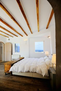 Wake up here with the gentle sea breeze coming through the window @Luxury Villa Aesara in Mykonos, Greece