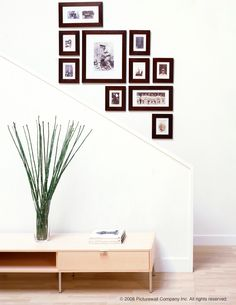 {Picture wall] kit photo-wall  sounds like an easy way to hang pictures. A have to remember when making my picture wall