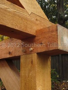 """Detail view of the jointwork on the structure. The posts and beams are 8 x8"""" solid cedar timbers."""