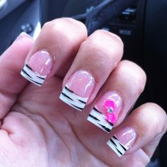 White tip with Zebra and pink glitter powder and a hot pink bow with a jewel