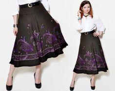A vintage wool midi skirt.  The model on the pictures is size S/36 and 165 cm height. Please check measurements with your own to avoid problems with the size. Make sure you double the measurements where shown (*2):  Label size: 38/ M Total lenght: 80 cm / 31.5 inches Waist: 42 cm *2 / 16.5 inches *2 Hips: 60.5 cm *2 / 23.75 inches *2 ( open ) Bottom Width: 126.5 cm *2 / 49.75 inches *2 (open)  Label: Basler Condition: good Colors: purple, beige, dark green Circa:...