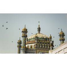 The enchanting beauty of Sachal Sarmast's #shrine  Abdul Wahab, fondly known by his disciples as Sachal Sarmast, (intoxicated man of god and truth) was born in 1739 in a village called Daraza in #Khairpur. He spread the message of #divine #love through his #poetry, which embodied the principles of #mysticism and according to him was 'divine' inspiration.  Photo: @shameenkbrohi / Dawn  #pakistan #poet #architecture #dawndotcom Sufi Saints, Godly Man, Mystic, Taj Mahal, Poetry, Architecture, Instagram Posts, Inspiration, Arquitetura