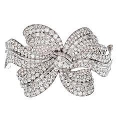 Incredible Art Deco bow motif 34 ct diamond bracelet, circa 1925.