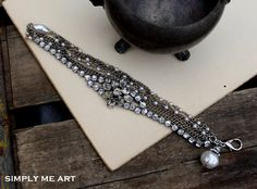 Vintage Pearl and Rhinestone Layered BraceletDolled by simplymeart, $68.00  A little over priced for how simple it is. I'm on the right track.