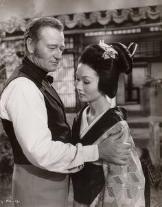 "John Wayne, Eiko Ando in ""The Barbarian and the Geisha"" (1958). Director: John Huston."