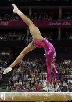 U.S. gymnast Gabrielle Douglas performs on the balance beam during the artistic gymnastics women's individual all-around competition at the 2012 Summer Olympics, Thursday, Aug. 2, 2012, in London.