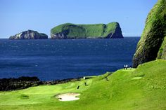 Vestmannaeyar golf course in Iceland. The golf course is set in an old volcano. Teeing off against a backdrop of volcanic walls, changing wind directions on the same hole and playing across and over the sea.