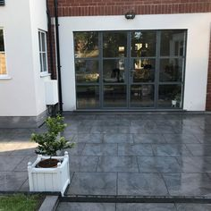 Inject a sense of pure luxury & style into your exterior with our Loft dark grey outdoor tiles. These durable tiles have a stunning concrete and stone effect and are designed for outdoor use as they are manufactured in a hard-wearing porcelain providing a minimalistic aesthetic and surface texture for higher slip resistance. In an on-trend slate grey colour tone they offer an on-trend solution for your outdoor patio or terrace. Why not coordinate with our Black Slate Split Face mosaic tiles…