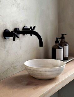 The beautiful Frama store in Copenhagen, housed in the former home of the St. Minimal bathroom ideas, black taps and marble sink.
