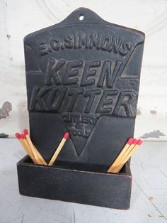 Vintage Keen Kutter Cast Iron Match Holder in a Rustic, Farmhouse Styleto hang beside your Fireplace, on your Kitchen wall or you can even use to hold Business Cards, Scissors, etc. It has a hole in the top for hanging on the wall or will stand upright on counter, table or hearth.  Made by E. C. Simmons Keen Kutter Cutlery & Tool Company, this sturdy vintage match caddie will make a charming Housewarming Gift as well as a perfect wall hanging for your vintage, primitive, country style dec...