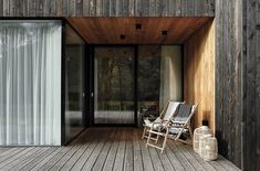 one-story family house in czech republic by ateliér kunc is covered with charred larch