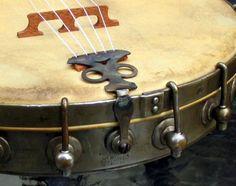 Nice detail. Older Banjo. Metal ring and Tail piece.