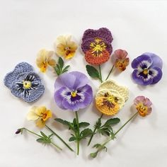 Excited that spring is right around the corner which means lighter yarns and fun little projects like this free pansy pattern from @intheyarngarden's blog -- they remind me of the cute little flowers in Disney's Alice in Wonderland! (photo credit / regram from the talented Charlotta of #intheyarngarden) • #crochetcrush #crochetpattern