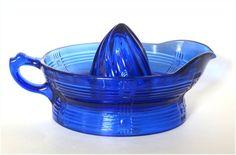 1930's Depression Glass Orange Reamer in Cobalt  http://img3.etsystatic.com/004/0/5441512/il_fullxfull.376830515_lmf5.jpg