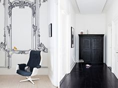 nice- really like the black and white espec. the wallpaper mirror and the skull pillow on the chair, and even though impractical- love the black floor!