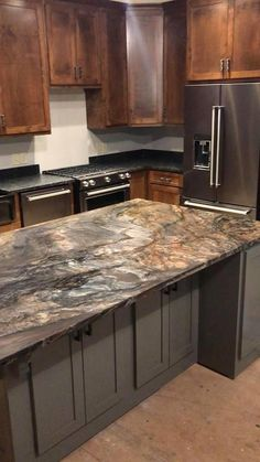 STUNNING Blue Fusion Leather Quartzite for the island and Steel Grey Leather for the exterior counters. These two go together well for an amazing outcome! Call us today for your free estimate. Quartzite Kitchen Island, Quartzite Countertops, Kitchen Countertops, Kitchen Cabinets, Cabinet Colors, Grey Leather, Kitchen Remodel, Kitchens, Exterior