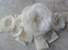 This listing is for a Enzoani inspired floral sash. Sash is handmade and hand sewn onto 2 inch ivory velvet and is 90 inches in length. Bridal Sash Belt, Wedding Dress Sash, Wedding Belts, Bridal Belts, Chic Wedding, Feather Hair Pieces, Evening Dresses For Weddings, Wedding Hair Flowers, Bandeau