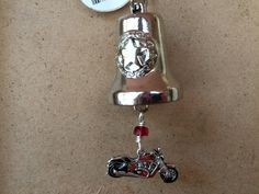 Unique and different motorcycle bell with a star and red motorcycle charm. by RealBeadDesigns on Etsy