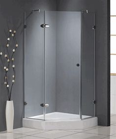 I love the corner shower frame with the simple gray walls. Glass Corner Shower, Glass Shower Doors, Downstairs Bathroom, Small Bathroom, Bathroom Ideas, Shower Bathroom, Garage Bathroom, Master Bathroom, Corner Shower Enclosures