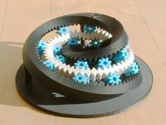 3D printed Möbius Gear Will Melt Your Mind: This Möbius gear is absolutely mind-bending, and almost impossible to describe. It's a toothed gear that only has one side, made by Berkeley robotics student Aaron Hoover using various 3-D printing methods. He was puzzling over an animation of such a gear in action and convinced himself that it could be made in real life. He turned out to be right.