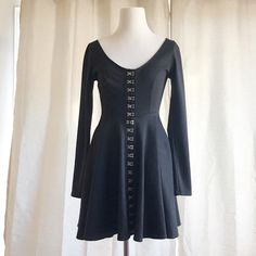 Urban Outfitters Black Corset Dress Long sleeve back dress with a flared a line skirt. Metal button up closure details add a edge to this flattering dress. Material is soft cotton. Best fits Small. Never worn. ❤️feel free to make an offer❤️ Dresses Mini
