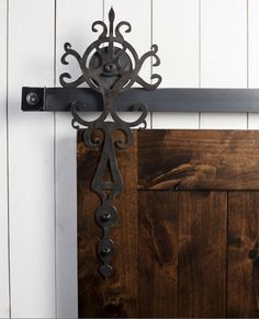 Sliding Barn Doors 101 - all you need to know when deciding if a sliding barn door will working your home and a terrific source for distinctive hardware.