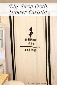diy drop cloth mermaid shower curtain for a nautical feel on your bathroom. It only costs $10 for the drop cloth! #showercurtain #diy #dropcloth
