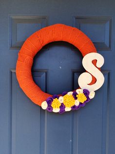 "New fall burlap wreath with felt flowers. I think the ""S"" completes it!"