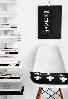 White chair & books | designjunkies.co loves you!