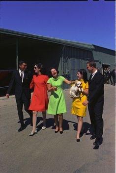 Lady Bird Johnson with daughters Lynda and Luci, and their husbands. (left to right) Charles Robb, Lynda Johnson, Lady Bird Johnson, Luci Johnson Nugent (holding the dog Yuki), Patrick Nugent, 30 September 1967