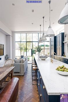The navy blue kitchen zone encompasses the contemporary country design, including a stunning six-metre-long marble-topped island and breakfast bar with plenty of space to receive guests. The white quartz worktop looks super fresh against the navy blue uni Home, Contemporary House, Open Plan Kitchen Living Room, Open Plan Kitchen, Interior, New Homes, Kitchen Diner Extension, House, Blue Kitchens