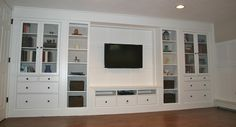 Create a built in out of stand alone pieces. Five IKEA pieces were used to create this 17 foot wide built in.