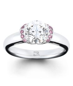 """Pretty in pink. """"Charme"""" features 10 fine pink brilliant cut diamonds, surrounding a round brilliant cut centre. This fully hand-made setting is available in 18 Wedding Engagement, Wedding Rings, Engagement Rings, White Sapphire, Diamond Rings, Pretty In Pink, Jewellery, Centre, Accessories"""