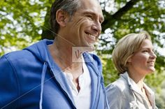 Middle aged couple jogging Stock Photo
