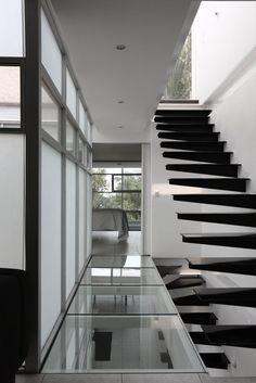 Glass corridor at staircase