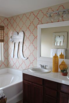 Very cute wall stenciling in a bathroom with our Large Moorish Trellis stencil from http://www.royaldesignstudio.com/