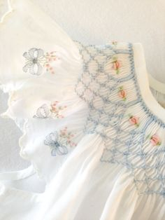 "Swiss batiste Angel Sleeve Bishop using embroidered Swiss edging as sleeves. Smocking plate is ""Elegant and Easy"" by Julia Golson, and pattern is ""Bishops and Bonnets"" by Chery Williams."