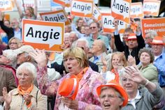 Supporters of German Chancellor Angela Merkel hold posters with her nickname at an election campaign rally in Winsen near Hamburg.